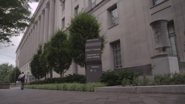 la cyclist riding past the department of justice building / washington dc, united states - department of justice stock videos & royalty-free footage