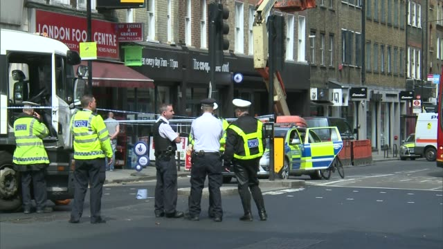 Cyclist seriously injured after colliding with lorry in Holborn ENGLAND London Holborn EXT Police vehicles and police officers at scene where lorry...