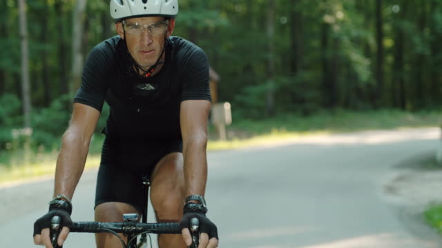 super slo mo cyclist sweating during the ride through the forest - 40 44 years stock videos & royalty-free footage