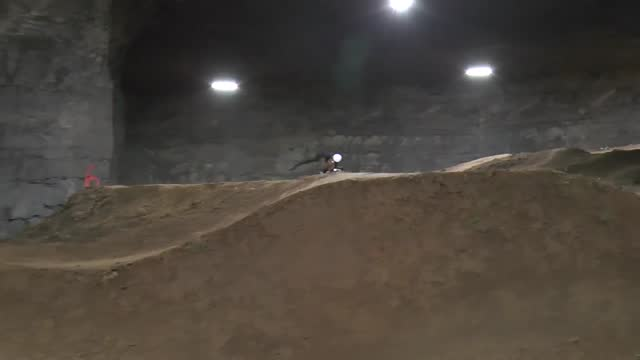 cyclist tommy board is pictured riding at the world's first underground bicycle park in louisville, kentucky. the park is built in what was once an... - mountain biking stock videos & royalty-free footage