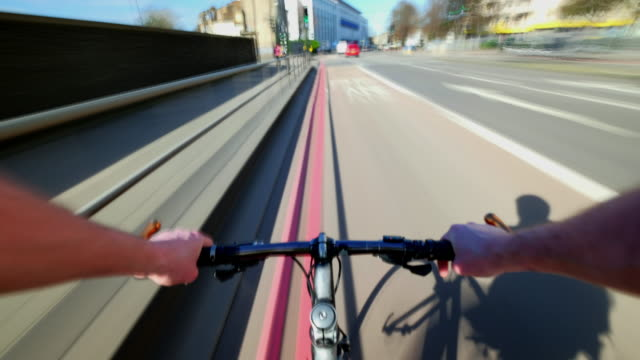 cyclist pov travelling north way from central london and through camden high street and camden market - cycling stock videos and b-roll footage