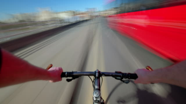 cyclist pov travelling over waterloo bridge and through the west end of central london - west end london stock videos and b-roll footage