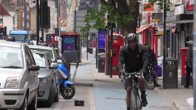 cyclist use one of london cycle paths as the prime minister announced the general contours of a phased exit from the current lockdown adopted nearly... - cycling stock videos & royalty-free footage