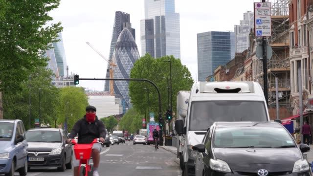cyclist use one of london cycle paths as the prime minister announced the general contours of a phased exit from the current lockdown adopted nearly... - footpath stock videos & royalty-free footage