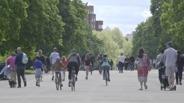 cyclists and walkers get out and exercise in hyde park during the coronavirus pandemic on may 02 2020 in london england the uk remains in full... - distant stock videos & royalty-free footage