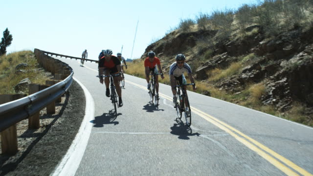 cyclists coming downhill - spandex stock videos & royalty-free footage