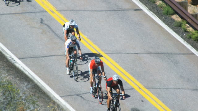 cyclists going downhill - professional sportsperson stock videos & royalty-free footage