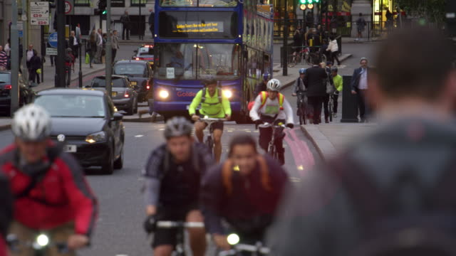 cyclists in busy london traffic - reflective clothing stock videos & royalty-free footage