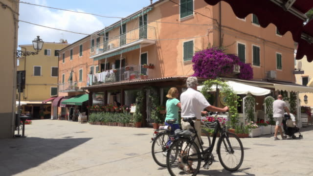 cyclists in old town of porto azzurro - island of elba stock videos & royalty-free footage