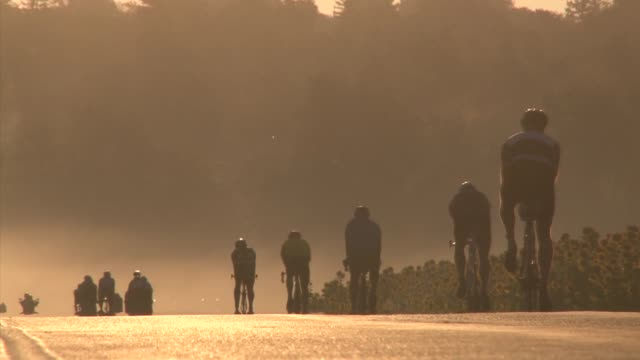 Cyclists in SOS Triathlon ride though early morning fog