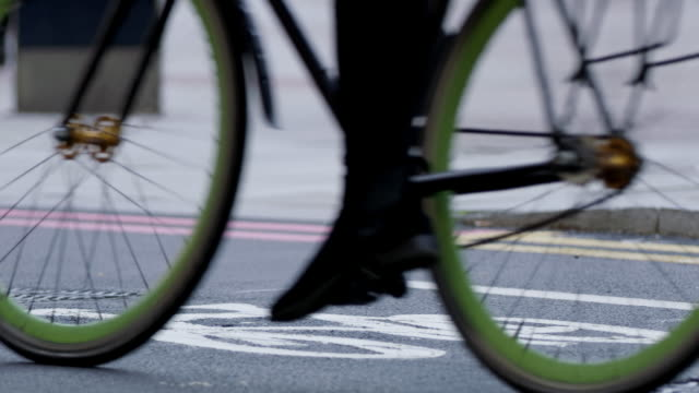 slo mo cyclists in the city - unrecognisable person stock videos and b-roll footage