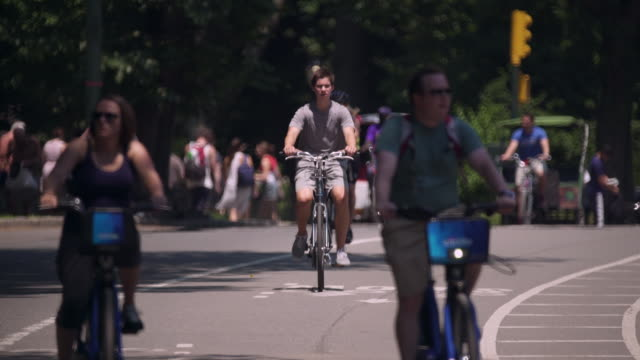 Cyclists in the park on a hot summer day.