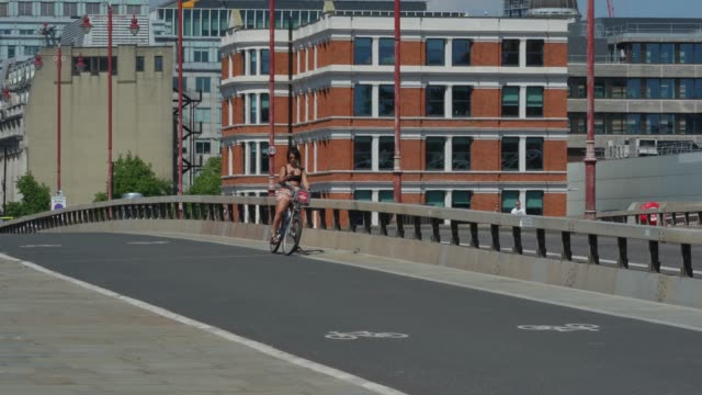 cyclists on a near empty southwark bridge during the afternoon as lock restrictions are eased on may 20 2020 in london england the british government... - bicycle stock videos & royalty-free footage