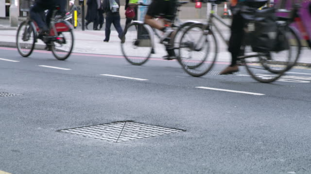 ws cyclists on the streets of london - low angle view stock videos & royalty-free footage