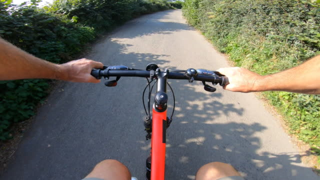 cyclist's point of view on a country lane. - bicycle trail outdoor sports stock videos & royalty-free footage