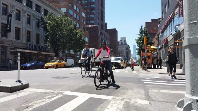 Cyclists ride along a Manhattan street on July 01 2019 in New York City As the nation's largest city tries to balance an increasing number of...