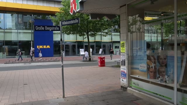 cyclists ride past an ikea ab high street store in hamburg germany pedestrians pass an ikea ab high street store in hamburg germany a metal frame bed... - window frame stock videos and b-roll footage