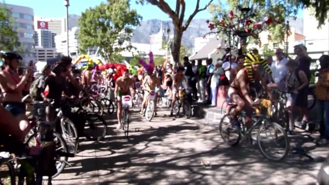 cyclists take to cape towns streets on saturday for the world naked bike ride which is held in several cities around the world. clean : offbeat cape... - cape town stock videos & royalty-free footage