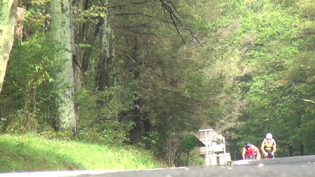 cyclists up hill toward camera triathlon - new paltz stock videos and b-roll footage