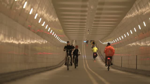 cyclists use the 'maastunnel' cycle path, about 1 km long on october 20 in rotterdam, the netherlands. traditionally a bicycle country the... - on the move stock videos & royalty-free footage