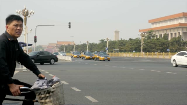 Cyclists waiting for traffic in a smoggy day in Beijing China