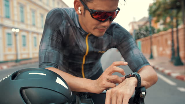 cyclists watch smart watches - cycling helmet stock videos & royalty-free footage