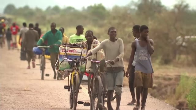 death toll rises to over 400 beira mozambique gvs refugees cyclone idai aftermath and damage to roads mozambique beira ext various shots people... - refugee stock videos & royalty-free footage