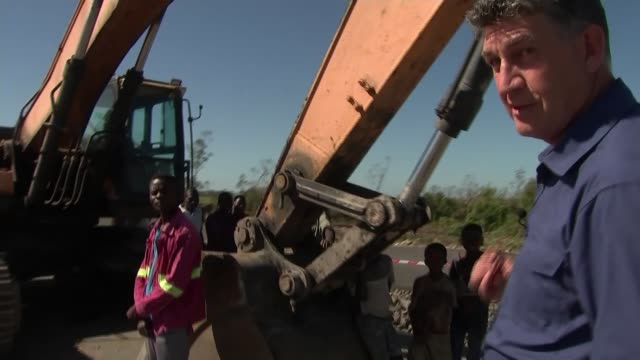 local people begin rebuilding work on devastated homes and villages mozambique beira and metushira village general views of metalled road out of... - bumpy stock videos & royalty-free footage