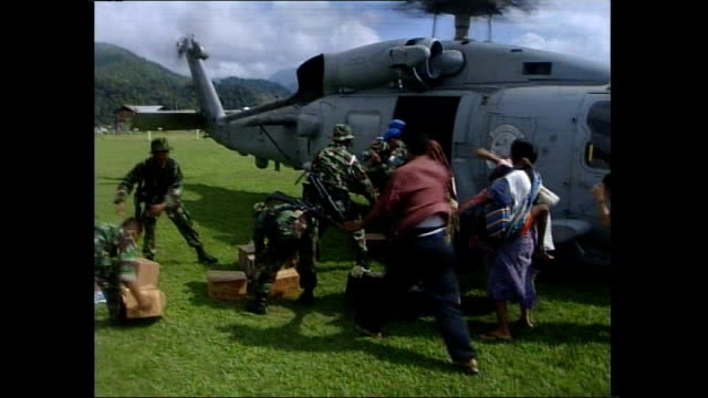 cyclone nargis/ one hundred thousand dead location people evacuated in helicopter following asian tsunami - 2004 stock-videos und b-roll-filmmaterial