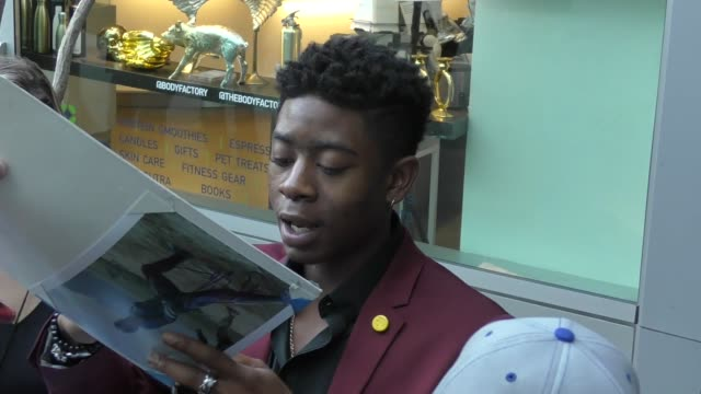rj cyler signs for fans at the premiere of netflix's sierra burgess is a loser at arclight cinemas in hollywood in celebrity sightings in los angeles - arclight cinemas hollywood stock videos & royalty-free footage