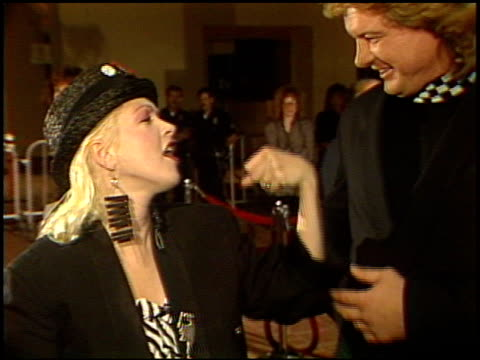 stockvideo's en b-roll-footage met cyndi lauper at the 'hail, hail, rock and roll' premiere on january 1, 1988. - cyndi lauper