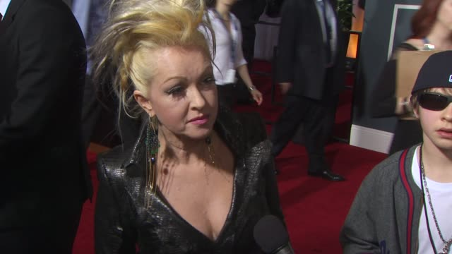 stockvideo's en b-roll-footage met cyndi lauper on performing at the show and why she wanted to team up with the artists she is performing with. at the 53rd grammy awards - arrivals... - cyndi lauper