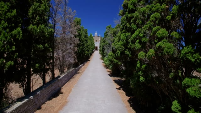 cypress avenue to hermitage of ermita de betlem in the mountains of artà ( serra artana or massís d'artà ) of balearic islands majorca / spain - 2010 2019 stock videos & royalty-free footage