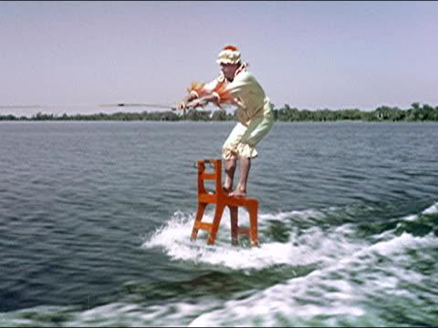 1956 cypress gardens waterskiing show - akrobat stock-videos und b-roll-filmmaterial