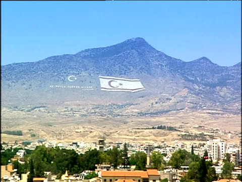 cypriot flag displayed on mountain under blue sky cyprus - republic of cyprus stock videos & royalty-free footage