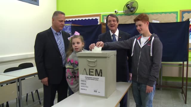 cypriot president and presidential candidate nicos anastasiades casts his ballot for presidential elections at a polling station in nicosia cyprus on... - eurasia stock videos and b-roll footage