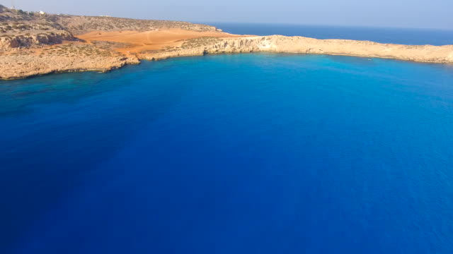cyprus, ayia napa, cape greco. aerial view. beautiful landscape and sea waves. blue lagoon - republic of cyprus stock videos and b-roll footage