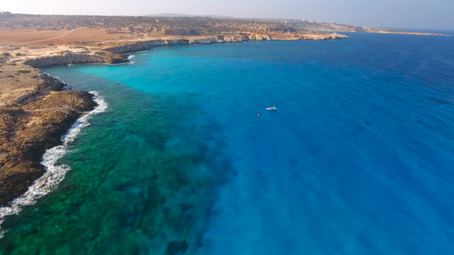 cyprus, ayia napa, cape greco. aerial view. beautiful landscape and sea waves. blue lagoon. - republic of cyprus stock videos & royalty-free footage