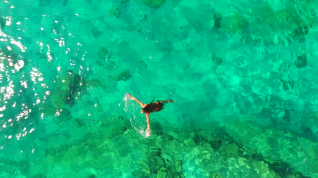 cyprus, ayia napa, cape greco. aerial view. girl in the sea. blue lagoon. aerial drone shot. - naked stock videos & royalty-free footage