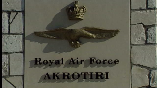 cyprus government in talks over controversial bailout deal r27039615 / 2731996 akrotiri ext entrance to raf akrotiri sign reading 'royal air force... - ファイサル・イスラム点の映像素材/bロール