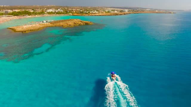 cyprus, nissi beach, ayia napa. aerial view. beautiful landscape and sea waves. - republic of cyprus stock videos & royalty-free footage