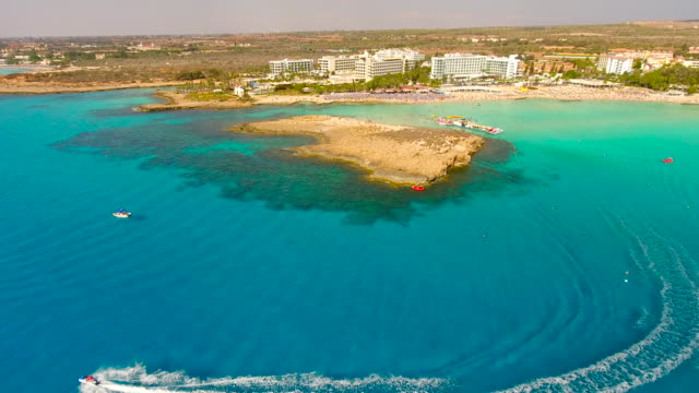 cyprus, nissi beach, ayia napa. aerial view. beautiful landscape and sea waves. - republic of cyprus stock videos and b-roll footage