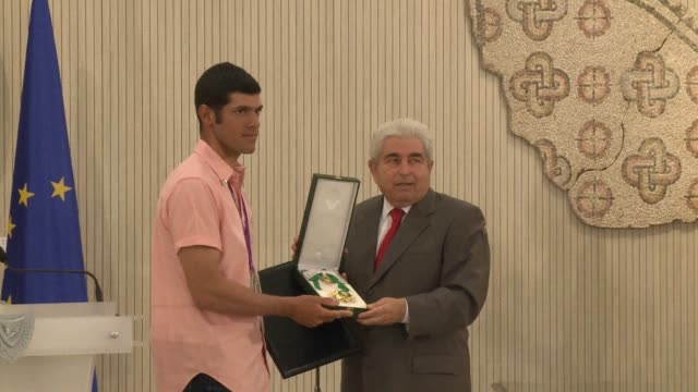 Cyprus president Demetris Christofias awarded the country's first ever Olympic medalist Pavlos Kontides who took the silver in sailing with the...