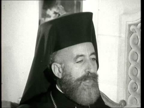 """kokkina refugee camp / archbishop makarios interview; b) cyprus: nicosia: int archbishop makarios iii : sof: - """"i have not visited the village of... - orthographic symbol stock videos & royalty-free footage"""