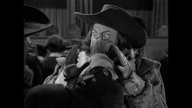 cyrano de bergerac (josé ferrer) gets into a dispute over his nose size - cyrano de bergerac stock-videos und b-roll-filmmaterial