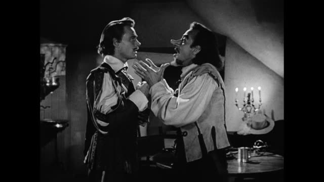 cyrano de bergerac (josé ferrer) gives a man (william prince) a lesson in writing poetry - cyrano de bergerac stock-videos und b-roll-filmmaterial