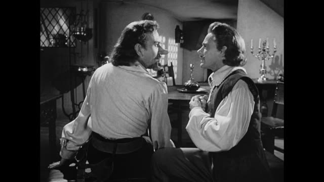 Cyrano De Bergerac (José Ferrer) offers  a man (William Prince) an ending for his line