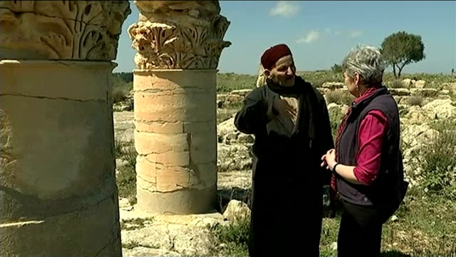 cyrene ext reporter along with professor abdel salam shallouf past archaeological ruins of grecoroman city of cyrene various shots of ruins of... - goddess stock videos and b-roll footage