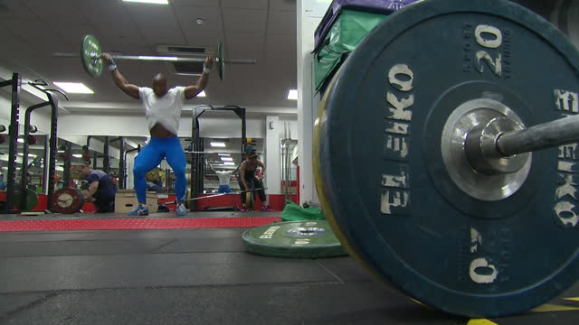 """cyrille tchatchet ii, part of the refugee olympic team in tokyo, training in his sport of weightlifting - """"bbc news"""" stock videos & royalty-free footage"""