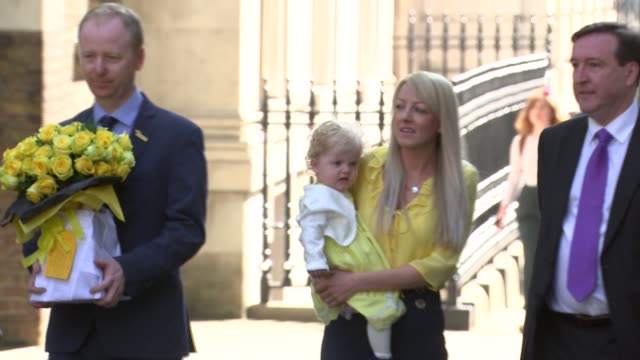 cystic fibrosis drug campaigners deliver petition to downing street; england: london: westminster: downing street: ext campaigners with yellow roses... - cystic fibrosis stock videos & royalty-free footage